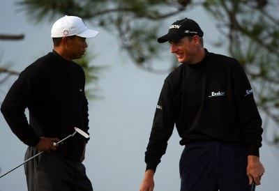 Jim Furyk (R) jokes with Tiger Woods on the fourth hole during the first round of the Buick Invitational at the Torrey Pines Golf Course January 24, 2008 in La Jolla, California. PGA TOUR - 2008 Buick Invitational - Round OnePhoto by Donald Miralle/Getty Images