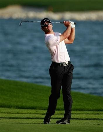 BAHRAIN, BAHRAIN - JANUARY 30:  Paul Casey of England hits his second shot on the 15th hole during the final round of the Volvo Golf Champions at The Royal Golf Club on January 30, 2011 in Bahrain, Bahrain.  (Photo by Andrew Redington/Getty Images)