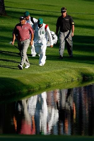AUGUSTA, GA - APRIL 11:  Angel Cabrera of Argentina (L), Todd Hamilton (R), caddie Ruben Yorio (3rd L) and caddie Kieran Docherty (2nd L) walk down the 16th hole during the third round of the 2009 Masters Tournament at Augusta National Golf Club on April 11, 2009 in Augusta, Georgia.  (Photo by Jamie Squire/Getty Images)