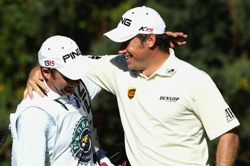SUN CITY, SOUTH AFRICA - DECEMBER 5:  Lee Westwood and caddie Billy Foster during the final round of the Nedbank Golf Challenge at Gary Player Country Club on December 05, 2010 in Sun City, South Africa.  (Photo by Luke Walker/Gallo Images/Getty Images)
