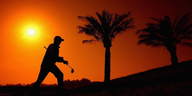 DOHA, QATAR - JANUARY 22:  (EDITOR'S NOTE: A FILTER WAS USED IN THE CREATION OF THIS DIGITAL IMAGE) Retief Goosen of South Africa makes his way to the 11th tee during the first round of the Commercialbank Qatar Masters at the Doha Golf Club on January 22, 2009 in Doha, Qatar.  (Photo by Ross Kinnaird/Getty Images)