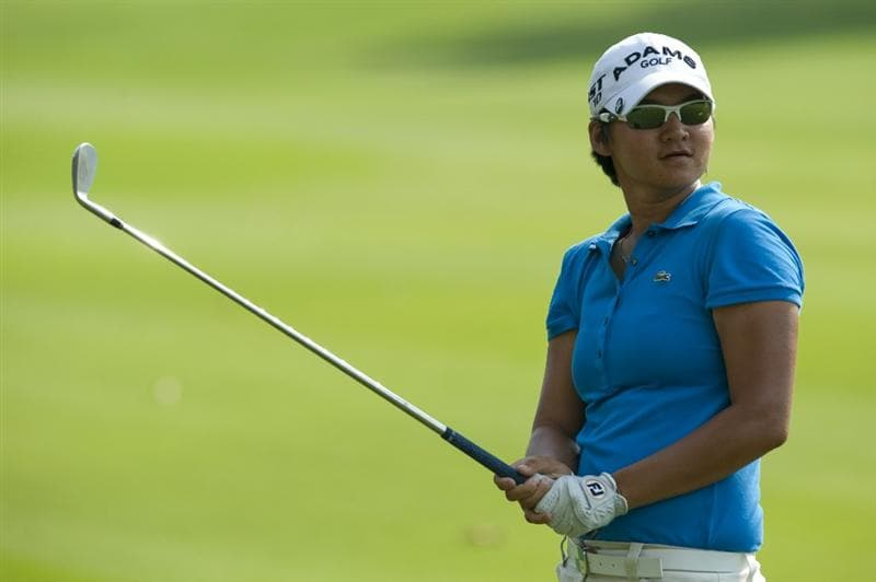 CHON BURI, THAILAND - FEBRUARY 19:  Yani Tseng of Taiwan plays her second shot on the 14th hole during day three of the LPGA Thailand at Siam Country Club on February 19, 2011 in Chon Buri, Thailand.  (Photo by Victor Fraile/Getty Images)