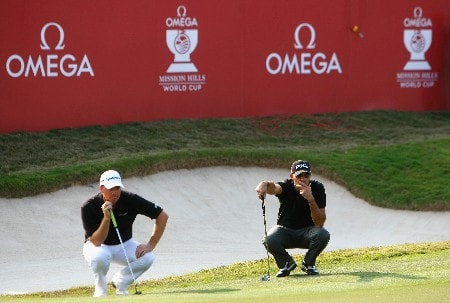 SHENZHEN, CHINA - NOVEMBER 24:  Peter Hanson of Sweden and Gregory Havret of France line up their putt on the 18th hole during the third round of the Omega Mission Hills World Cup at the Mission Hills Golf Resort on November 24, 2007 in Shenzhen, China.  (Photo by Stuart Franklin/Getty Images)