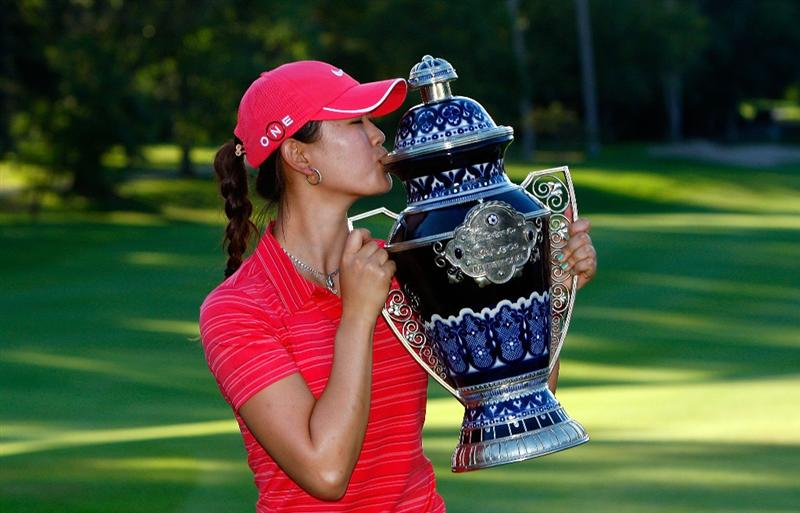 GUADALAJARA, MEXICO - NOVEMBER 15:  Michelle Wie of the United States kisses the trophy after winning the Lorena Ochoa Invitational Presented by Banamex and Corona at Guadalajara Country Club on November 15, 2009 in Guadalajara, Mexico.  (Photo by Kevin C. Cox/Getty Images)