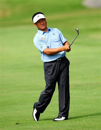 HONOLULU, HI - JANUARY 15:  K.J. Choi of South Korea plays a shot on the 10th hole during the second round of the Sony Open at Waialae Country Club on January 15, 2010 in Honolulu, Hawaii.  (Photo by Sam Greenwood/Getty Images)