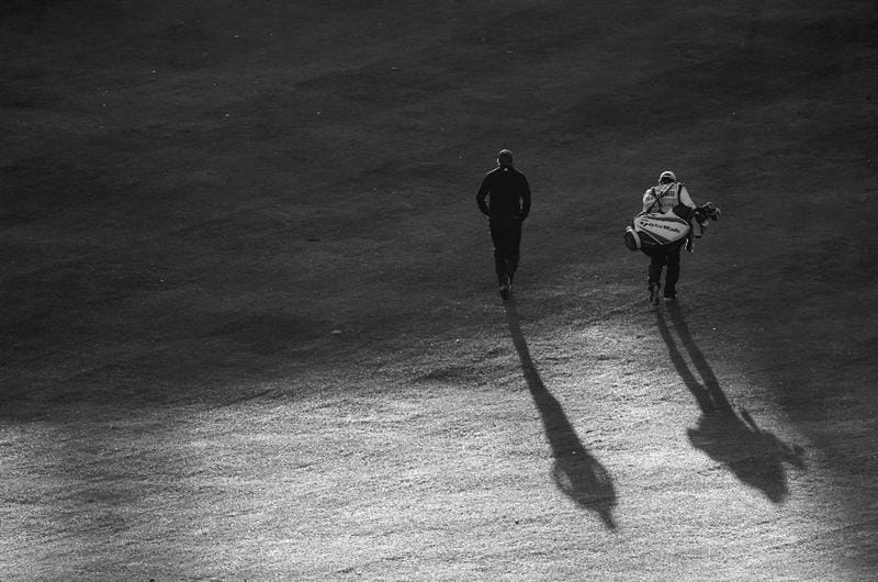 PARIS - SEPTEMBER 26:  (EDITORS NOTE: THIS BLACK AND WHITE IMAGE WAS CREATED FROM ORIGINAL COLOUR FILE). Sion Bebb of Wales and his caddie walk up the first hole during the final round of the Vivendi cup at Golf de Joyenval on September 26, 2010 in Chambourcy, near Paris, France.  (Photo by Stuart Franklin/Getty Images)