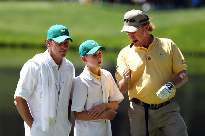 AUGUSTA, GA - APRIL 06:  Miguel Angel Jimenez of Spain poses with his caddie Pepin Liria and son Victor during the Par 3 Contest prior to the 2011 Masters Tournament at Augusta National Golf Club on April 6, 2011 in Augusta, Georgia.  (Photo by Andrew Redington/Getty Images)