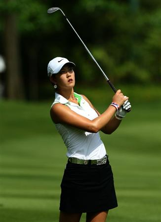 KUALA LUMPUR, MALAYSIA - OCTOBER 22:  Michelle Wie of USA watches her 2nd shot on the 1st hole during Round One of the Sime Darby LPGA on October 22, 2010 at the Kuala Lumpur Golf and Country Club in Kuala Lumpur, Malaysia. (Photo by Stanley Chou/Getty Images)