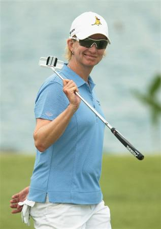 SINGAPORE - FEBRUARY 27:  Karrie Webb of Australia smiles as she walks to the 18th green during the final round of the HSBC Women's Champions 2011 at the Tanah Merah Country Club on February 27, 2011 in Singapore, Singapore.  (Photo by Scott Halleran/Getty Images)