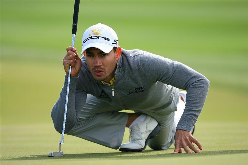 MARANA, AZ - FEBRUARY 20:  Camilo Villegas of Colombia lines up a putt on the tenth hole during round four of the Accenture Match Play Championship at the Ritz-Carlton Golf Club on February 20, 2010 in Marana, Arizona.  (Photo by Hunter Martin/Getty Images)