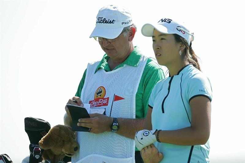 GALLOWAY, NJ - JUNE 18:  Yoo Kyeong Kim of South Korea waits with her caddy to play during the first round of the ShopRite LPGA Classic held at Dolce Seaview Resort (Bay Course) on June 18, 2010 in Galloway, New Jersey.  (Photo by Michael Cohen/Getty Images)