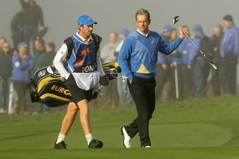 NEWPORT, WALES - OCTOBER 04:  Luke Donald of Europe walks with his caddie John McLaren to the first green in the singles matches during the 2010 Ryder Cup at the Celtic Manor Resort on October 4, 2010 in Newport, Wales.  (Photo by Ross Kinnaird/Getty Images)