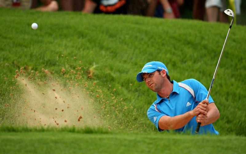 SUN CITY, SOUTH AFRICA - DECEMBER 06:  Sergio Garcia of Spain plays from a greenside bunker on the 2nd during the third round of the Nedbank Golf Challenge at the Gary Player Country Club on December 6, 2008 in Sun City, South Africa.  (Photo by Richard Heathcote/Getty Images)