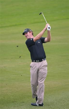 SAN ANTONIO TX - MAY 14: Greg Owen of England  hits his approach shot into the 9th hole during the first round of  the Valero Texas Open held at La Cantera Golf Club on May 14, 2009 in San Antonio, Texas (Photo by Marc Feldman/Getty Images)