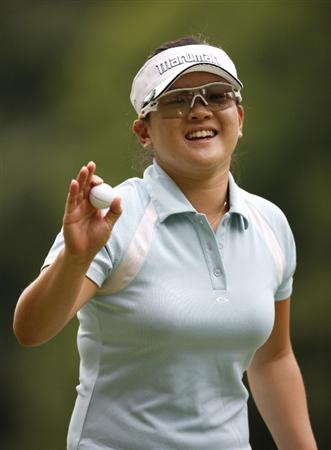 SYLVANIA, OH - JULY 04:  Eunjung Yi of South Korea waves to fans after making a  birdie putt on the 17th green during the third round of the Jamie Farr Owens Corning Classic at Highland Hills Golf Club on July 4, 2009 in Sylvania, Ohio.  (Photo by Gregory Shamus/Getty Images)