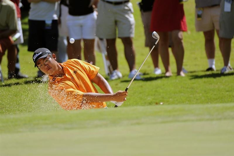 TULSA, OK - AUGUST 30:  Byeong-Hun An hits out of a bunker as spectators look on during the Finals of the U.S. Amateur Golf Championship on August 30, 2009 at Southern Hills Country Club in Tulsa, Oklahoma.  (Photo by G. Newman Lowrance/Getty Images)
