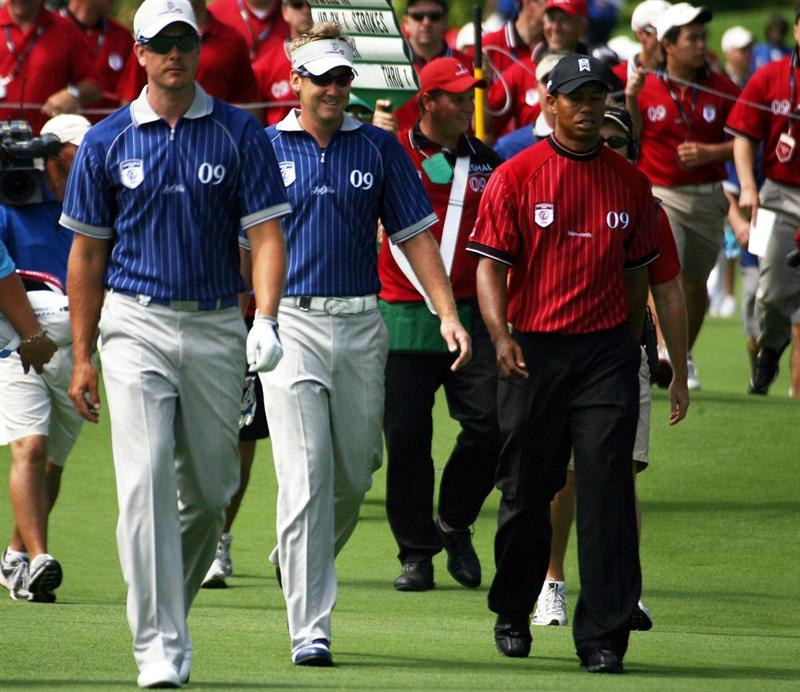 ORLANDO, FL - MARCH 17:  Tiger Woods (R) walks off after teeing off on the second hole with Henrik Stenson (L) and Ian Poulter (C) at the Tavistock Cup on March 17, 2009 at Lake Nona Country Club in Orlando, Florida.  (Photo by Marc Serota/Getty Images)