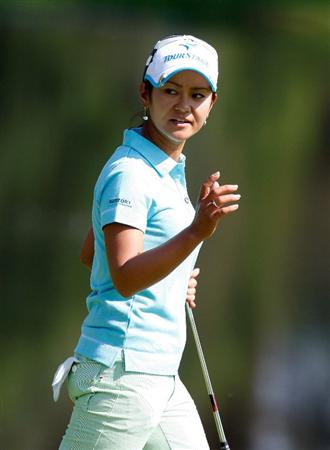 GUADALAJARA, MEXICO - NOVEMBER 12:  Ai Miyazato of Japan acknowledges the gallery after her putt on the fourth green during the first round of the Lorena Ochoa Invitational Presented by Banamex and Corona at Guadalajara Country Club on November 12, 2009 in Guadalajara, Mexico.  (Photo by Kevin C. Cox/Getty Images)