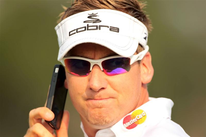 PONTE VEDRA BEACH, FL - MAY 11:  Ian Poulter of England uses his phone during a practice round prior to the start of THE PLAYERS Championship held at THE PLAYERS Stadium course at TPC Sawgrass on May 11, 2011 in Ponte Vedra Beach, Florida.  (Photo by Scott Halleran/Getty Images)