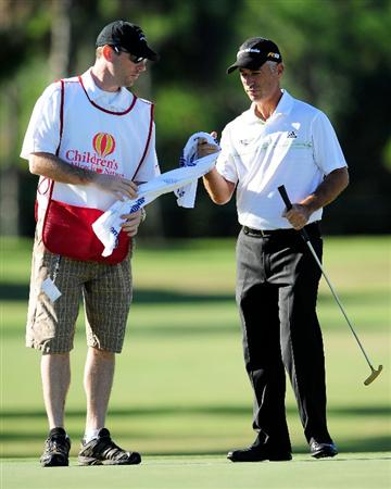 LAKE BUENA VISTA, FL - NOVEMBER 13:  Corey Pavin and caddie Mike Ehrmann wait to play a shot on the 16th hole during the second round of the Children's Miracle Network Classic at the Disney Palm and Magnolia courses on November 13, 2009 in Lake Buena Vista, Florida.  (Photo by Sam Greenwood/Getty Images)