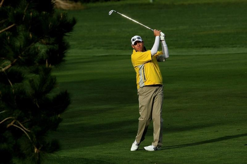 PEBBLE BEACH, CA - FEBRUARY 11:  Brian Davis of England hits his second shot on the first hole during the first round of the AT&T Pebble Beach National Pro-Am at Pebble Beach Golf Links on February 11, 2010 in Pebble Beach, California.  (Photo by Stephen Dunn/Getty Images)