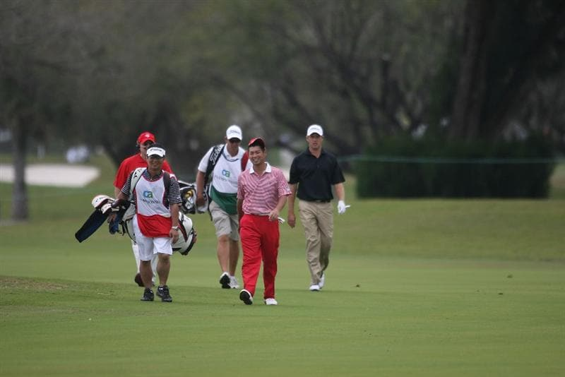 DORAL, FL - MARCH 11:  Yuta Ikeda of Japan walks up the 12th fairway during round one of the 2010 WGC-CA Championship at the TPC Blue Monster at Doral on March 11, 2010 in Doral, Florida.  (Photo by Marc Serota/Getty Images)