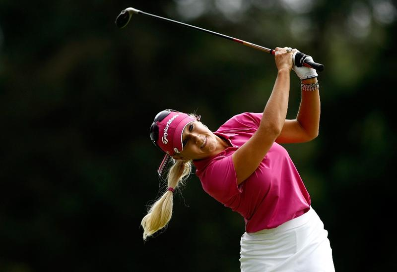 NORTH PLAINS, OR - AUGUST 29:  Natalie Gulbis tees off on the 14th during the second round of the Safeway Classic on August 29, 2009 on the Ghost Creek course at Pumpkin Ridge in North Plains, Oregon.  (Photo by Jonathan Ferrey/Getty Images)