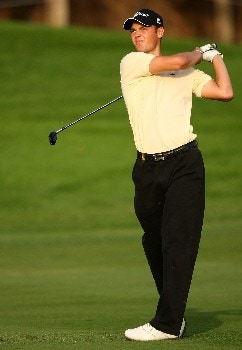 DUBAI, UNITED ARAB EMIRATES - JANUARY 31: Martin Kaymer of Germany watches his second shot on the 18th hole during the first round of the Dubai Desert Classic on the Majilis course at Emirates Golf Club on January 31, 2008 in Dubai, United Arab Emirates. (Photo by Andrew Redington/Getty Images)