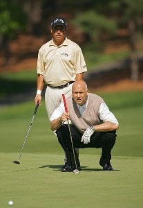 Olin Browne lines up a shot with former Baltimore Oriole Cal Ripken Jr. during the Pro-Am prior to the 2006 Wachovia Championship at the Quail Hollow Club in Charlotte, North Carolina on May 3, 2006.Photo by Sam Greenwood/WireImage.com