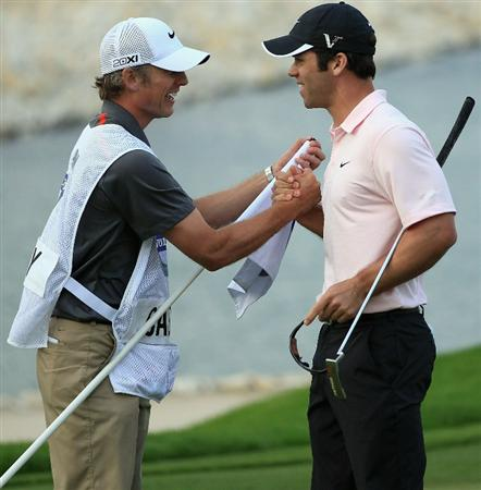 BAHRAIN, BAHRAIN - JANUARY 30:  Paul Casey of England celebrates with his caddie Christian Donald on the 18th green after winning the Volvo Golf Champions at The Royal Golf Club on January 30, 2011 in Bahrain, Bahrain.  (Photo by Andrew Redington/Getty Images)