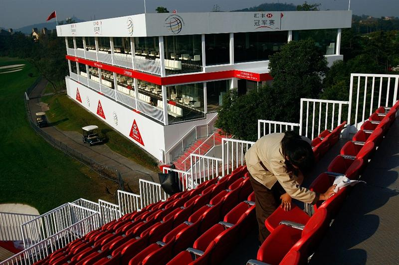 SHANGHAI, CHINA - NOVEMBER 03:  A member of the grounds staff prepares the grandstand seats on the 18th hole during a practice round prior to the start of the WGC-HSBC Champions at Sheshan International Golf Club on November 3, 2009 in Shanghai, China.  (Photo by Scott Halleran/Getty Images)