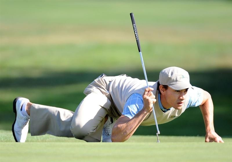 SAN FRANCISCO - OCTOBER 09:  Camilo Villegas of the International Team lines up his putt on the 13th hole during the Day Two Fourball Matches of The Presidents Cup at Harding Park Golf Course on October 9, 2009 in San Francisco, California.  (Photo by Harry How/Getty Images)