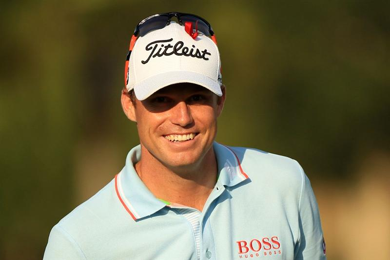 PONTE VEDRA BEACH, FL - MAY 14:  Nick Watney smiles as he waits on the practice ground during the third round of THE PLAYERS Championship held at THE PLAYERS Stadium course at TPC Sawgrass on May 14, 2011 in Ponte Vedra Beach, Florida.  (Photo by Streeter Lecka/Getty Images)