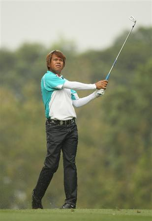 HONG KONG - NOVEMBER 18:  Thammanoon Srirot of Thailand looks on after playing a shot during day one of the UBS Hong Kong Open at The Hong Kong Golf Club on November 18, 2010 in Hong Kong, Hong Kong.  (Photo by Ian Walton/Getty Images)