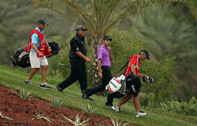 ABU DHABI, UNITED ARAB EMIRATES - JANUARY 21:  Charl Schwartzel of South Africa and Darren Clarke of Northern Ireland during the second round of the Abu Dhabi HSBC Golf Championship at the Abu Dhabi Golf Club on January 21, 2011 in Abu Dhabi, United Arab Emirates.  (Photo by Ross Kinnaird/Getty Images)