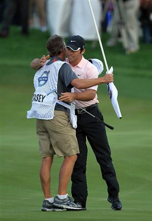BAHRAIN, BAHRAIN - JANUARY 30:  Paul Casey of England embraces his caddy Christian Donald of England after he had holed the winning putt on the 18th green during the final round of the 2011 Volvo Champions held at the Royal Golf Club on January 30, 2011 in Bahrain, Bahrain.  (Photo by David Cannon/Getty Images)