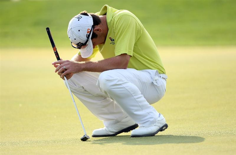 DOHA, QATAR - JANUARY 24:  Louis Oosthuizen of South Africa looks dejected after missing a putt on the 13th hole during the third round of  the Commercialbank Qatar Masters at Doha Golf Club on January 24, 2009 in Doha, Qatar.  (Photo by Andrew Redington/Getty Images)