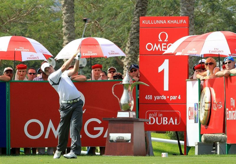 DUBAI, UNITED ARAB EMIRATES - FEBRUARY 12:  Marc Warren of Scotland plays his tee shot at the 1st hole during the third round of the 2011 Omega Dubai Desert Classic on the Majilis Course at the Emirates Golf Club on February 12, 2011 in Dubai, United Arab Emirates.  (Photo by David Cannon/Getty Images)