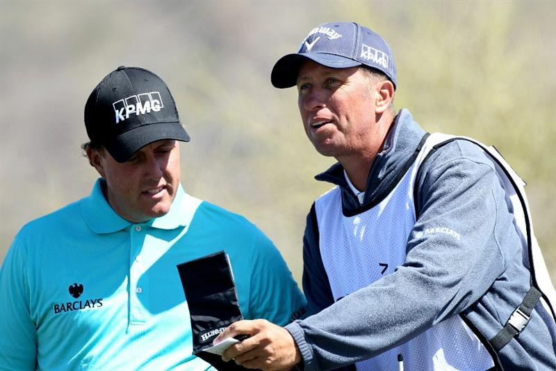 MARANA, AZ - FEBRUARY 23: Phil Mickelson and caddie Jim 'Bones' Mackay look at the yardage book on the second hole during the first round of the Accenture Match Play Championship at the Ritz-Carlton Golf Club on February 23, 2011 in Marana, Arizona.  (Photo by Sam Greenwood/Getty Images)