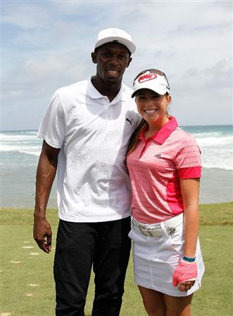 MONTEGO BAY, JAMAICA - APRIL 16:  Usain Bolt and Paula Creamer of the United States pose for a photo during the semifinal matches of The Mojo 6 Jamaica LPGA Invitational at Cinnamon Hill Golf Course on April 16, 2010 in Montego Bay, Jamaica.  (Photo by Kevin C. Cox/Getty Images)