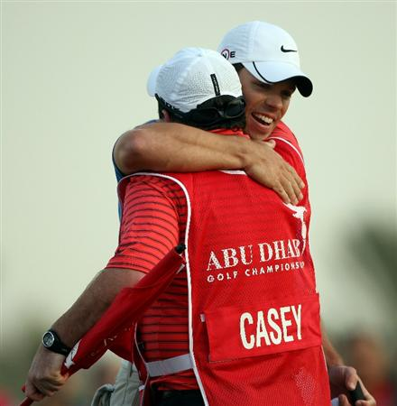 ABU DHABI, UNITED ARAB EMIRATES - JANUARY 18:  Paul Casey of England celebrates with his caddie Craig Connelly on the 18th hole after winning The Abu Dhabi Golf Championship at Abu Dhabi Golf Club on January 18, 2009 in Abu Dhabi, United Arab Emirates.  (Photo by Andrew Redington/Getty Images)