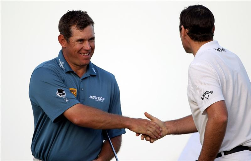 DOHA, QATAR - JANUARY 30:  Lee Westwood of England (left) shakes hands with Oliver Wilson of England on the 18th hole during the third round of the Commercialbank Qatar Masters at Doha Golf Club on January 30, 2010 in Doha, Qatar.  (Photo by Andrew Redington/Getty Images)
