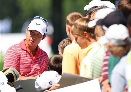 BLOOMFIELD HILLS, MI - AUGUST 06:  Anthony Kim signs his autograph for fans during a practice round prior to the 90th PGA Championship at Oakland Hills Country Club on August 6, 2008 in Bloomfield Township, Michigan.  (Photo by Stuart Franklin/Getty Images)