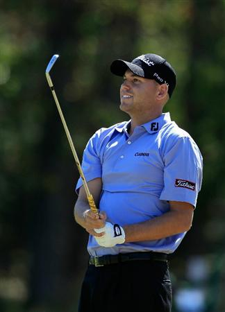 MADISON, MS - SEPTEMBER 30: Bill Haas watches his shot from the rough during the first round of the Viking Classic held at Annandale Golf Club on September 30, 2010 in Madison, Mississippi.  (Photo by Michael Cohen/Getty Images)