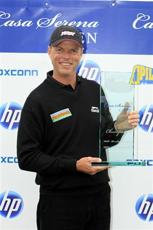 KUTNA HORA, CZECH REPUBLIC - SEPTEMBER 19:  Gary Wolstenholme of England poses with the trophy after the final round of the Casa Serena Open played at Casa Serena Golf on September 19, 2010 in Kutna Hora, Czech Republic.  (Photo by Phil Inglis/Getty Images)