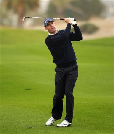 BAHRAIN, BAHRAIN - JANUARY 28:  Padraig Harrington of Ireland plays his second shot on the 11th hole during the second round of the Volvo Golf Champions at The Royal Golf Club on January 28, 2011 in Bahrain, Bahrain.  (Photo by Andrew Redington/Getty Images)