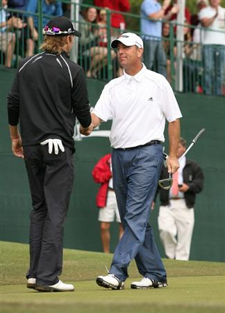 ATHENS, GA - APRIL 19: (R-L) Patrick Sheehan shakes hands with Michael Sim of Australia after birding the first playoff hole to win the Athens Regional Foundation Classic at Jennings Mill Country Club on April 19, 2009 in Athens, Georgia. (Photo by Hunter Martin/Getty Images)