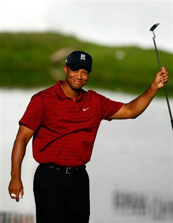 LEMONT, IL - SEPTEMBER 13:  Tiger Woods celebrates his eight-stroke victory on the 18th green at the BMW Championship held at Cog Hill Golf & CC on September 13, 2009 in Lemont, Illinois.  (Photo by Scott Halleran/Getty Images)