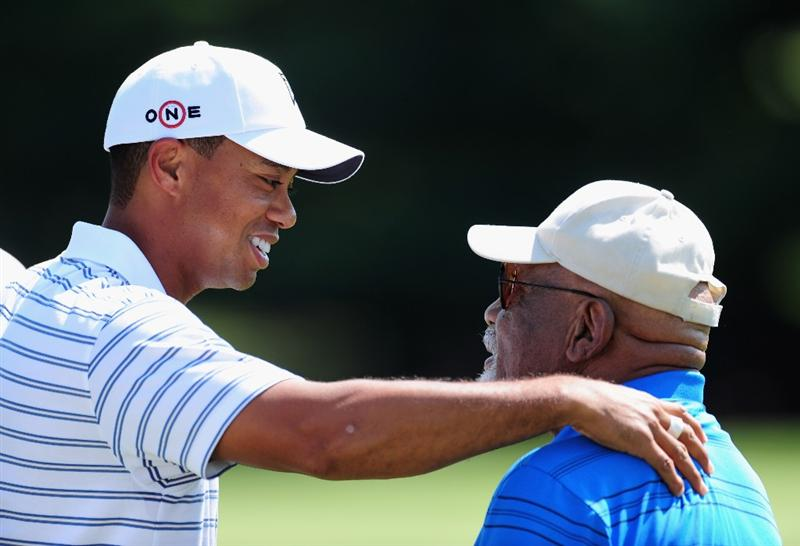 AKRON, OH - AUGUST 05:  Tiger Woods of USA speaks with Charlie Sifford the first African American inducted into the World Golf Hall of Fame during a practice round of the World Golf Championship Bridgestone Invitational on August 5, 2009 at Firestone Country Club in Akron, Ohio.  (Photo by Stuart Franklin/Getty Images)