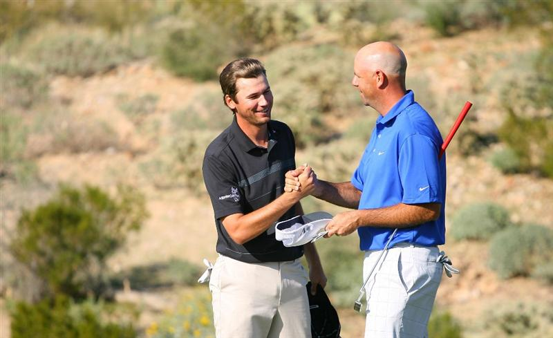 MARANA, AZ - FEBRUARY 18:  Sean O'Hair and Stewart Cink shakes hands after completing their round on the 18th hole during round two of the Accenture Match Play Championship at the Ritz-Carlton Golf Club on February 18, 2010 in Marana, Arizona.  (Photo by Hunter Martin/Getty Images)
